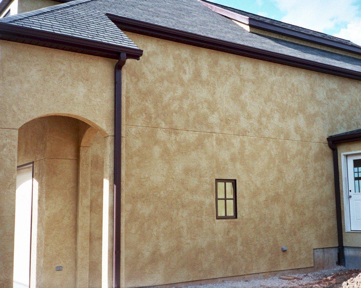 Отделка фасада декоративным камнем фото